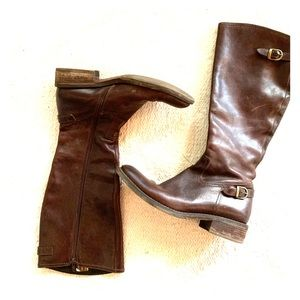 Cordani tall brown leather riding boots.